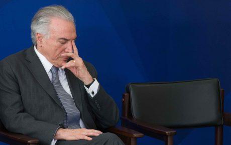 Brazil's president Michel Temer markets us dollar