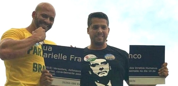 Daniel Silveira, destroying a street name sign that honored Marielle Franco