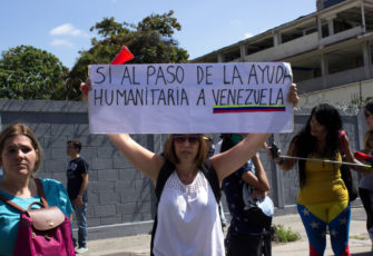 Demonstrators demand humanitarian aid during a protest against the Nicolas Maduro