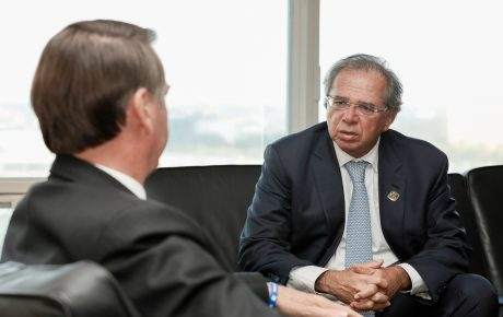 Jair Bolsonaro (L) and Economy Minister Paulo Guedes