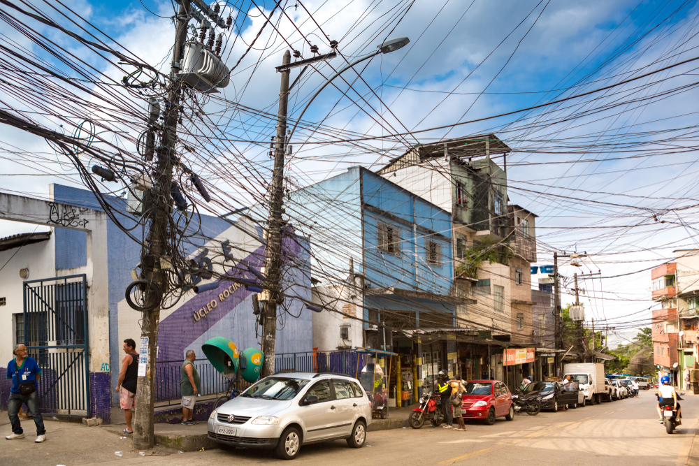 Messy electrical and telecom wires hang above the street