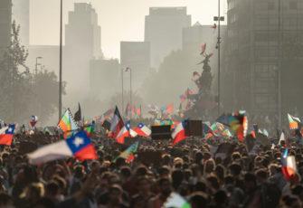 democracy People crowds protesting at Santiago de Chile. Photo: AbriendoMundo/Shutterstock