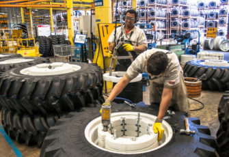 Workers mount tractors at tractors and machines factory, in Mogi das Cruzes. Photo: Alf Ribeiro/Shutterstock